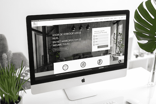 mockup of an imac at a modern office with decorative plants 2145 el optimized