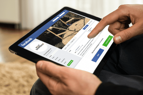 mockup of a man using an ipad in landscape position 2044 el1 optimized